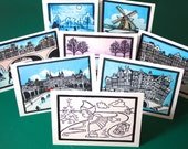 Dutch Christmas cards: Pick any 10. Snowy winter scenes, Amsterdam, windmill, Rijksmuseum, skating, canal houses, colouring in for kids.