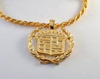 Vintage 1980's gold plated metal CADILLAC collectible emblem Necklace new old stock