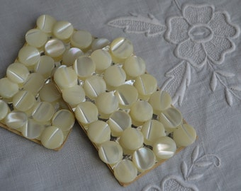 Card of 24 tiny MOP buttons from the 1940s
