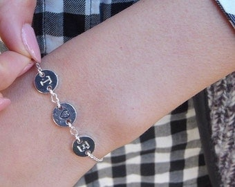 Bracelet with heart and initials carved in silver