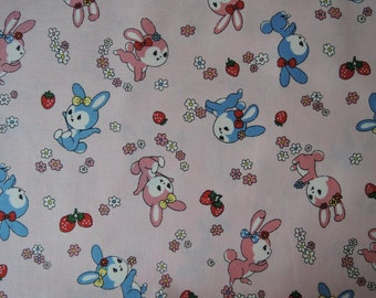 "Fat Quarter of Yuwa Atsuko Matsuyama 30's Collection Bunnies, Strawberries and Floral Fabric on Pink Background. Approx. 18"" x 22"