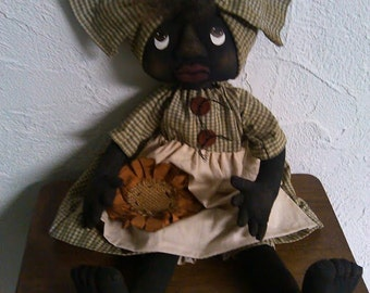 Primitive Black Folk Art Doll and Sunflower