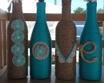 Upcycled Wine Bottles wrapped in twine and rope LOVE design. Wedding decor, home decor, bottle decor, recycled bottles.