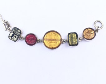Colorful glass and silver bracelet with toggle clasp.