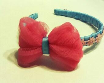 Baby blue ribbon headband with pink bow