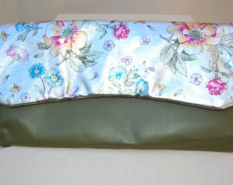 Two tone convertible clutch in butter-soft Italian lambskin, with an extraordinary floral silver flap.