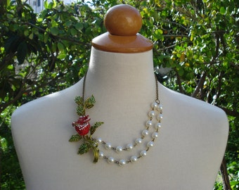 Amazing Nature Inspired Bib Statement Necklace.Pretty Rose Bud Flower with Red and Green Rhrinestones is Hand Wire Wrapped with Ivory Pearls