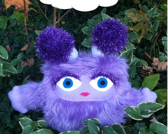 Plumly the Brumblewump. Caretaker of the Troublewumps - She is Not a Monster! Purple, furry stuffed animal.  Cute children's book character.