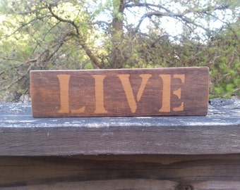 Rustic wood LIVE signs.