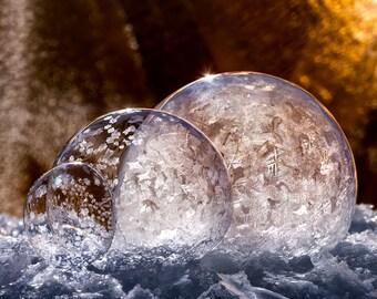 Three golden bubbles