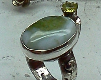 Green druzy with peridot sterling silver ring.