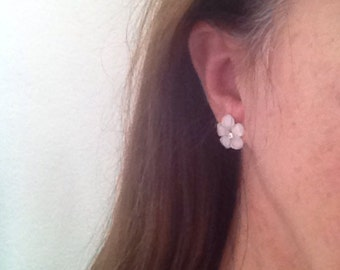 White flower earrings with rhinestone centers