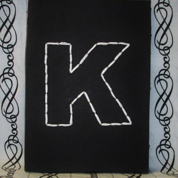 decorative letter k black and white typography hand embroidery