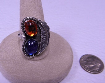 This ring is a treated glass size 9.
