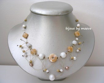 costume jewelry necklace beige and white circles