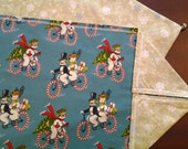 New handcrafted reversible vintage snowmen riding bicycles and snowflake table runner with decorative stitch and silver bells