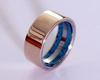 Titanium mens ring with bronze and inlaid with turquoise in the inlside