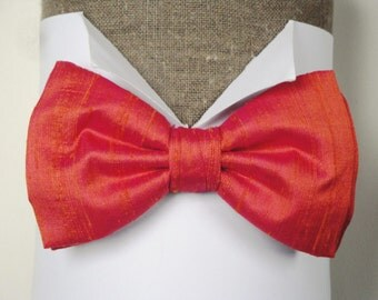 "Bow tie, pre tied or self tie, salmon pink silk dupion, adjustable neck band, will fit up to neck size 19.5"" (48cms)"