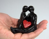 """Lovers sculpture   """"You & Me""""   one-of-a-kind kiss statue with sculpted heart"""