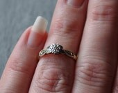 Art Deco 9ct gold and platinum diamond solitaire ring