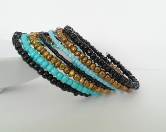Memory wire bracelet. Turquoise and gold Swarovski crystals