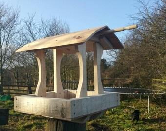 Traditional style bird feeder station.