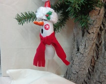 Singing Snowman gourd ornament wearing a Santa hat,  hand painted gourd art by Debbie Easley