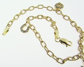 Vintage 14 K gold charm bracelet with 3 good luck charms.