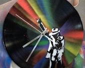 Moonwalker. Spray painted vinyl record, clock