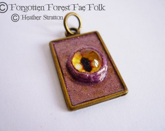 Yellow dragon eye pendant