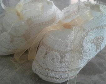Delicate handmade baby booties
