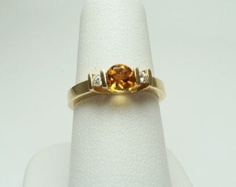 Round Cut Citrine Ring with Diamond on each side, set in 14 KT Yellow Gold, .52 carat weight. Size 6 1/2. CR 71.Inventory Reduction Sale
