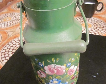antique milk can which is painted