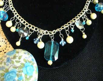 Turquoise Faceted Beads, Pearls, and Chandelier Crystals on a Silver Plated Double Chain Necklace