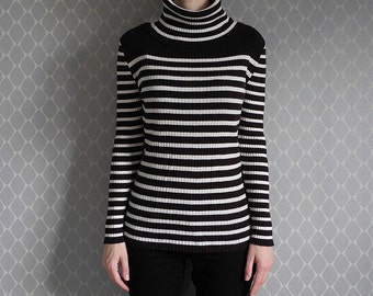 Brown and white striped turtleneck jumper