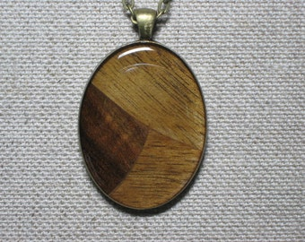 Black Walnut wood freeform, resin encased in antique brass finish pendant bezel with chain