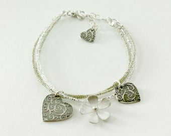 Three hearts and a flower bracelet