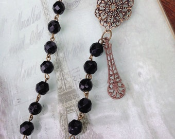Jet black vintage czech glass beaded necklace with brass ox-plated filigree details. Beautiful!