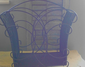 vintage magazine rack ,black metal and wire solid curved sides with curved wire front and back. original paint,.
