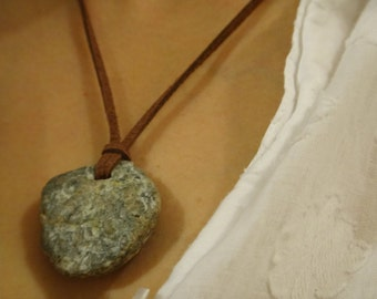 Natural stone aglommeration on suede necklace . Pebble rough stone. Very sleek stone pendant .