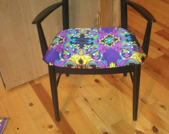 Black painted arm chair with  modern seat cover