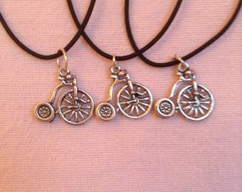 Penny farthing bike necklace.