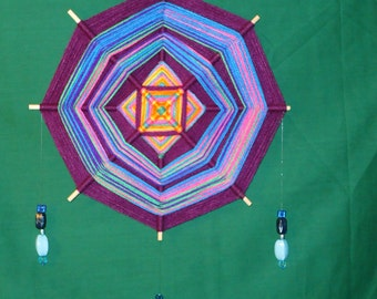 Purple Ojo de Dios with Blue bead embellishments