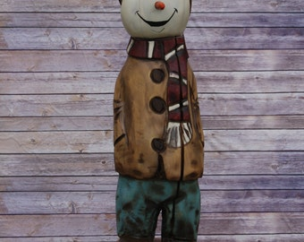 Snow Child, Chainsaw carving, Painted and sealed.          All one of a kind