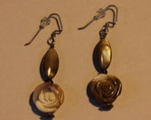 Tiger's eye oval combined with a polished rose shaped resin beaded earring.