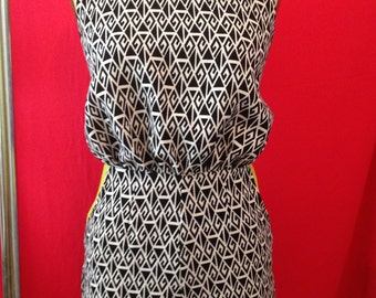 Black and white print play suit with pop of colour