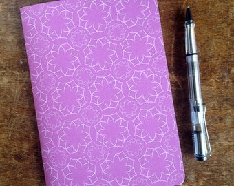A5 paper journal/notebook featuring a pink and white graphic floral pattern