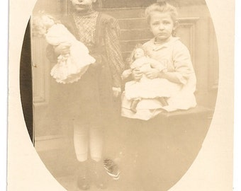 Little girls with dolls postcard sisters Id-d Shully girls