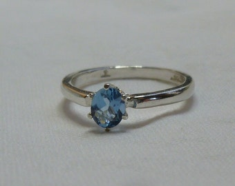 5mm x 4mm oval cut .60 ct blue zircon sterling silver ring size 4.5
