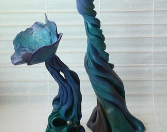 Beauty and Promise. flower and bud sculptures, blue, green, and purple organic life forms